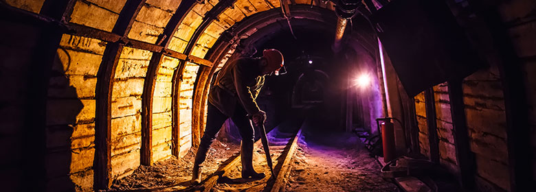 Miner working in a tunnel