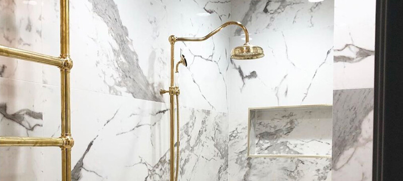 Polished Brass Shower Fixtures Transform This Shower