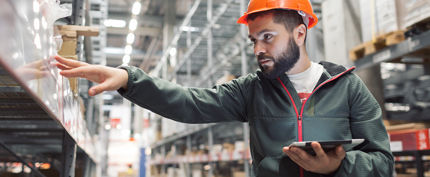 Employee Using Vendor-Managed Inventory Platforms to Track Inventory
