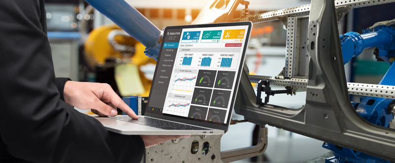 An Employee Uses a Dashboard Connected to the Internet of Things (IoT) to Manage Productivity
