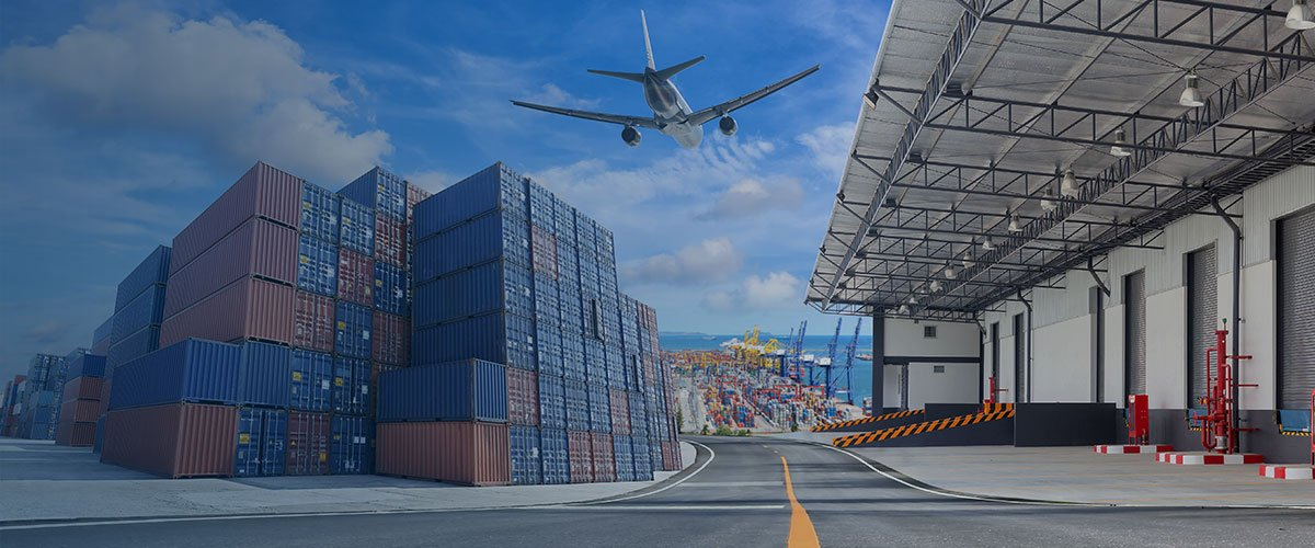 Airplane flying over supply chain cargo center